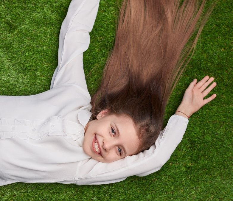 girl smiling artificial grass